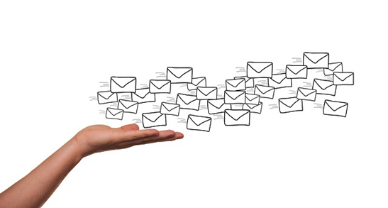 A lot of e-mails being sent away from a palm of a hand.